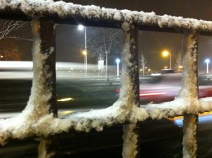 Snow on a fence along Lake Shore Drive.